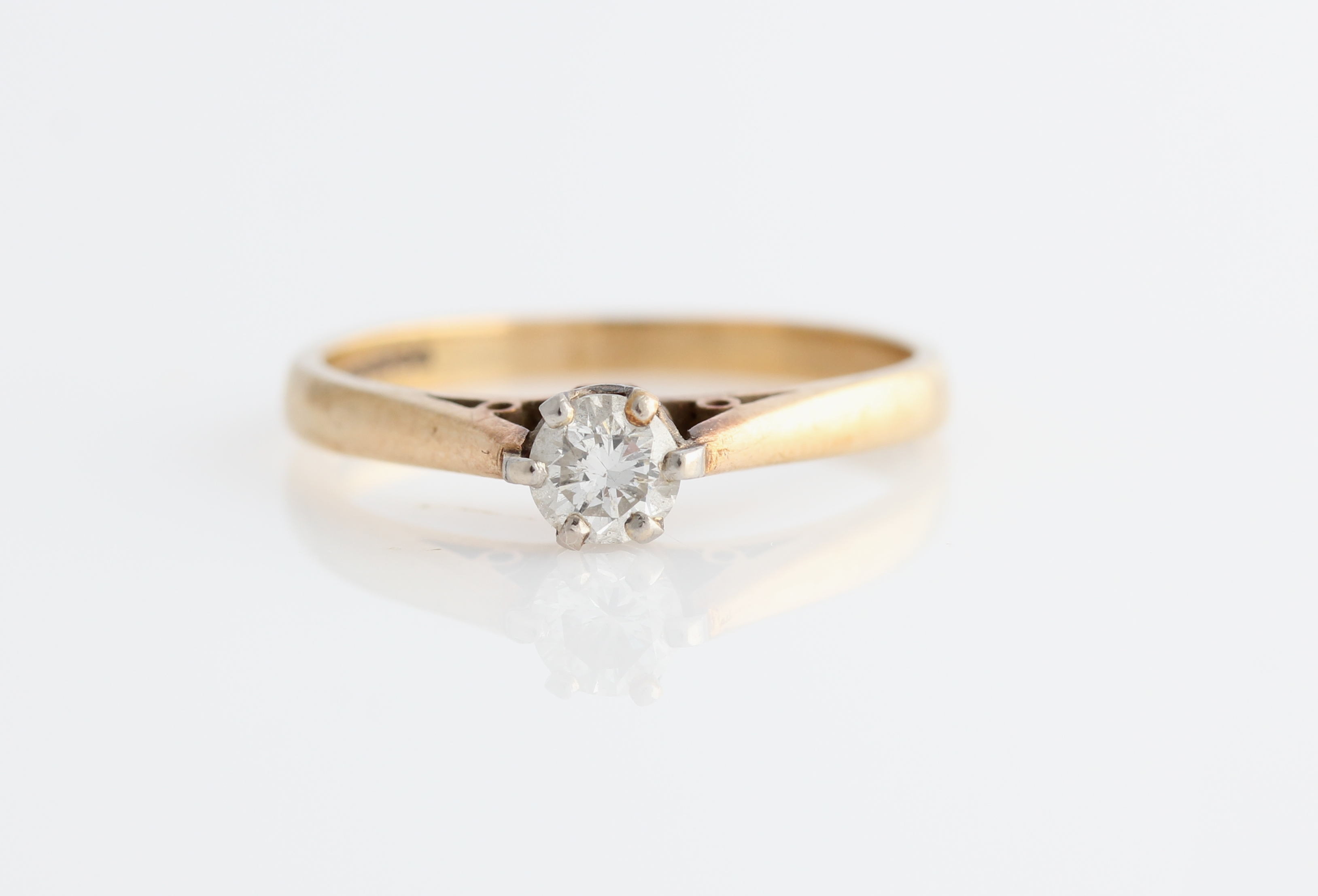 Lot 51 - A hallmarked 9ct yellow gold diamond solitaire ring, set with a round brilliant cut diamond,