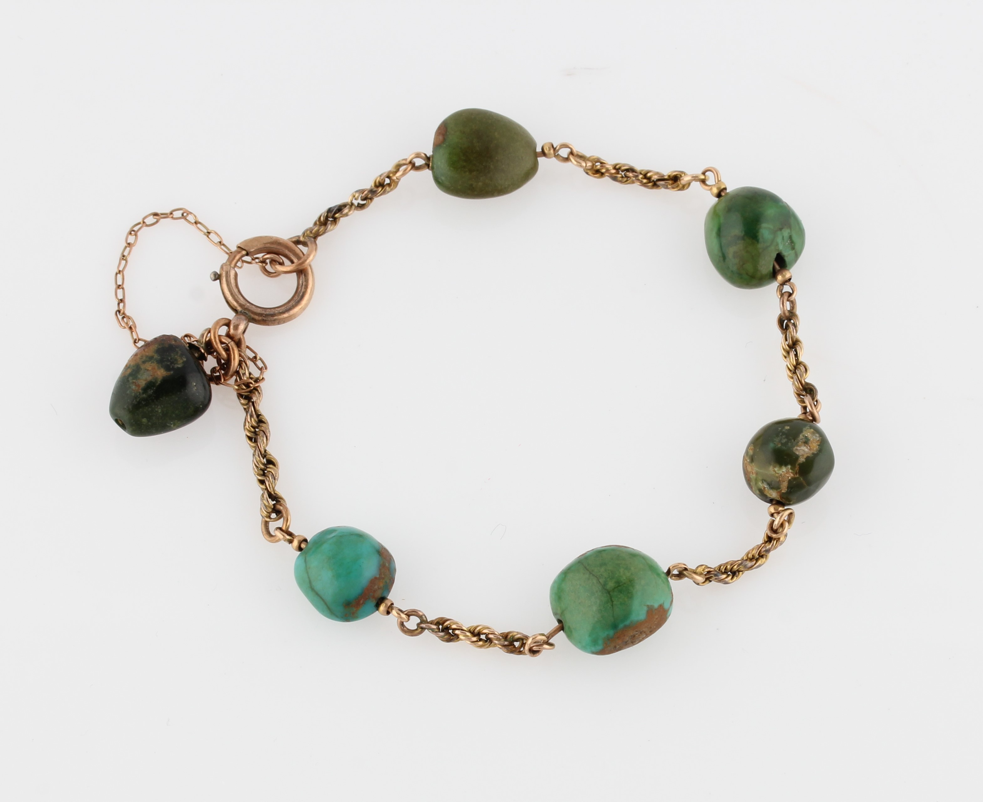 Lot 37 - A turquoise bracelet, the rope twist chain set with six tumbled pieces of turquoise, unmarked yellow