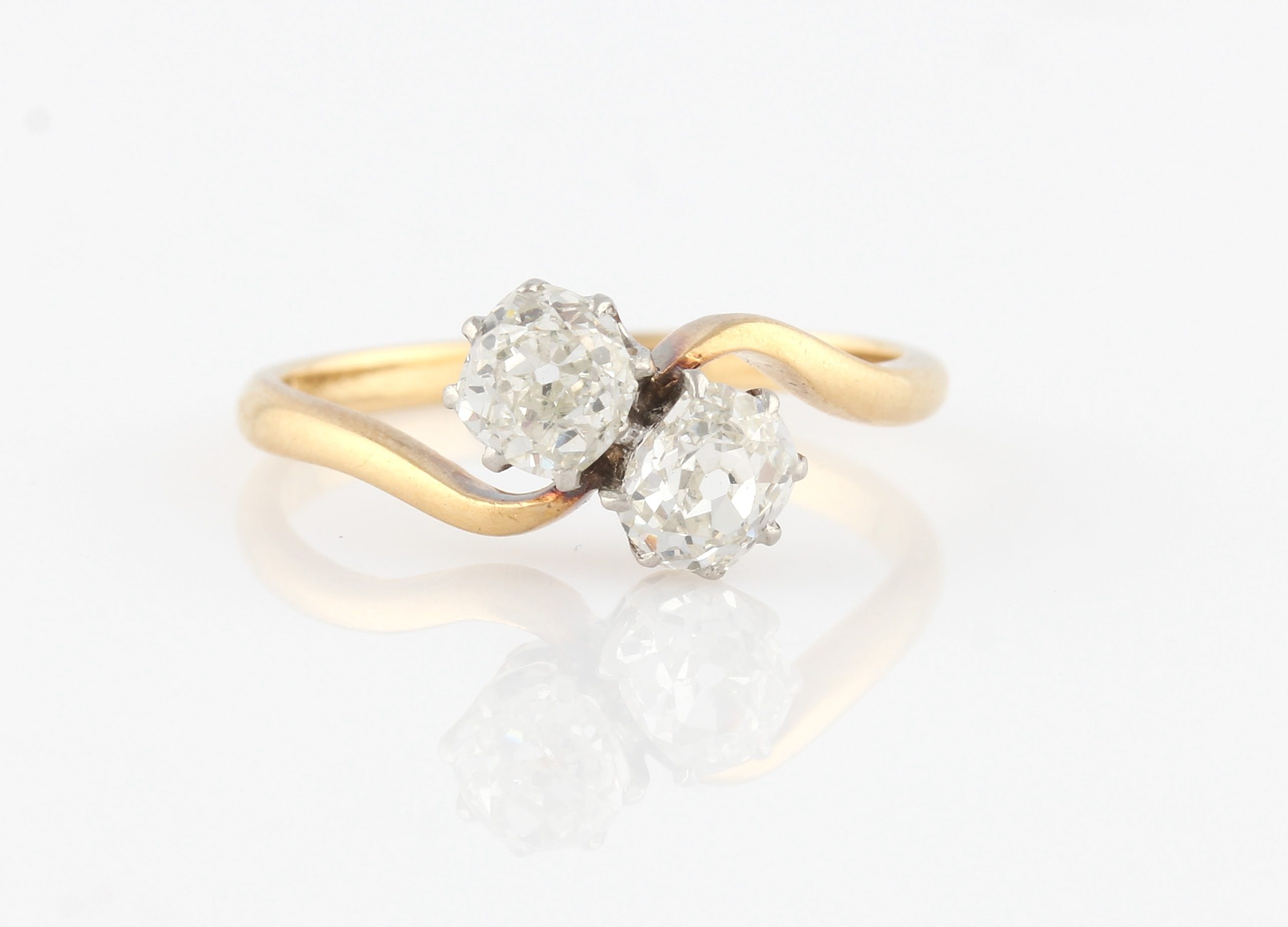 Lot 3 - A two stone diamond ring, set with two old cut diamonds, each measuring approx. 0.50ct, in a cross