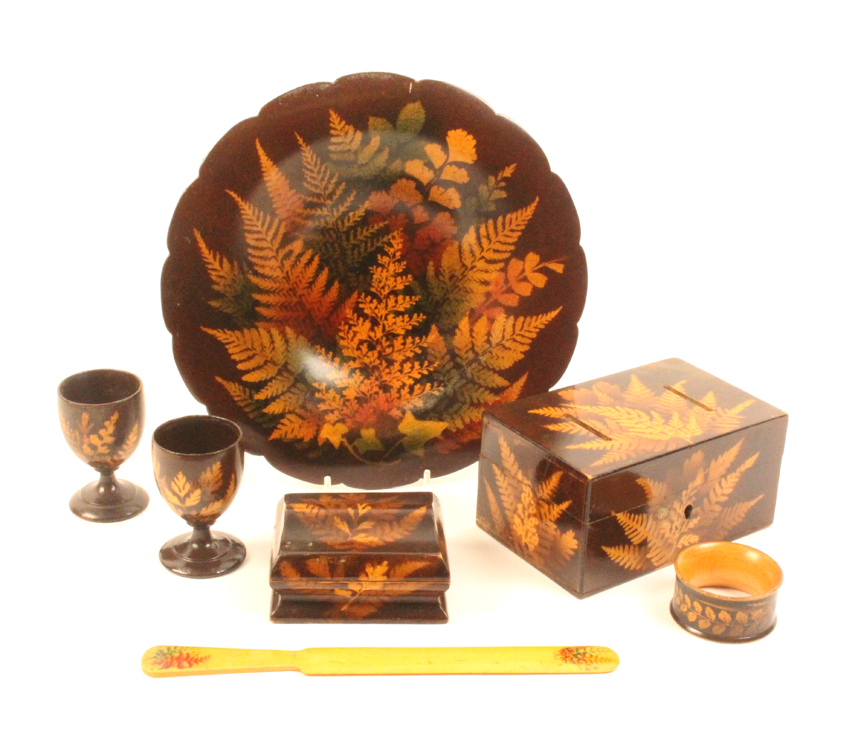 Lot 43 - Fern ware - seven pieces comprising a shaped border circular dish, coloured ferns on a brown ground,