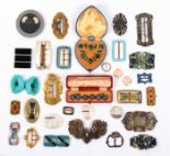 Lot 705 - Two cased sets of buttons and a collection of buckles comprising two leather cased sets, each of six