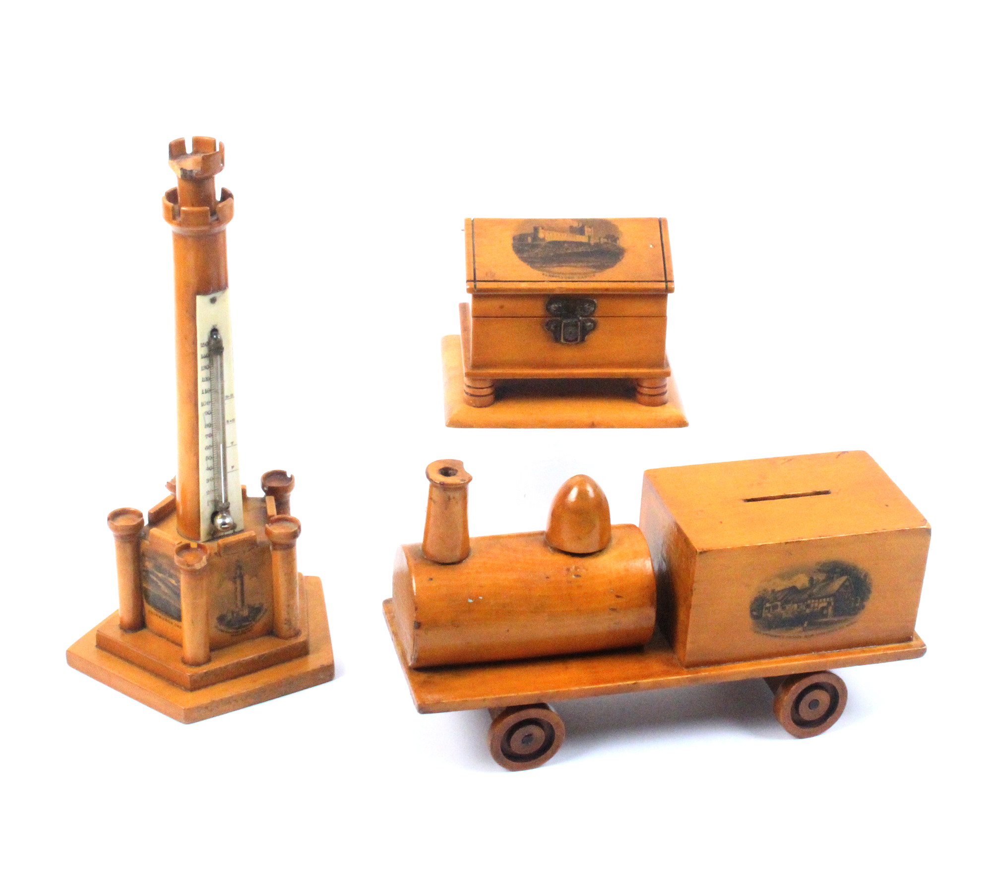 Lot 57 - Mauchline ware - three pieces - comprising a money box in the form of a train (Ann Hathaway's