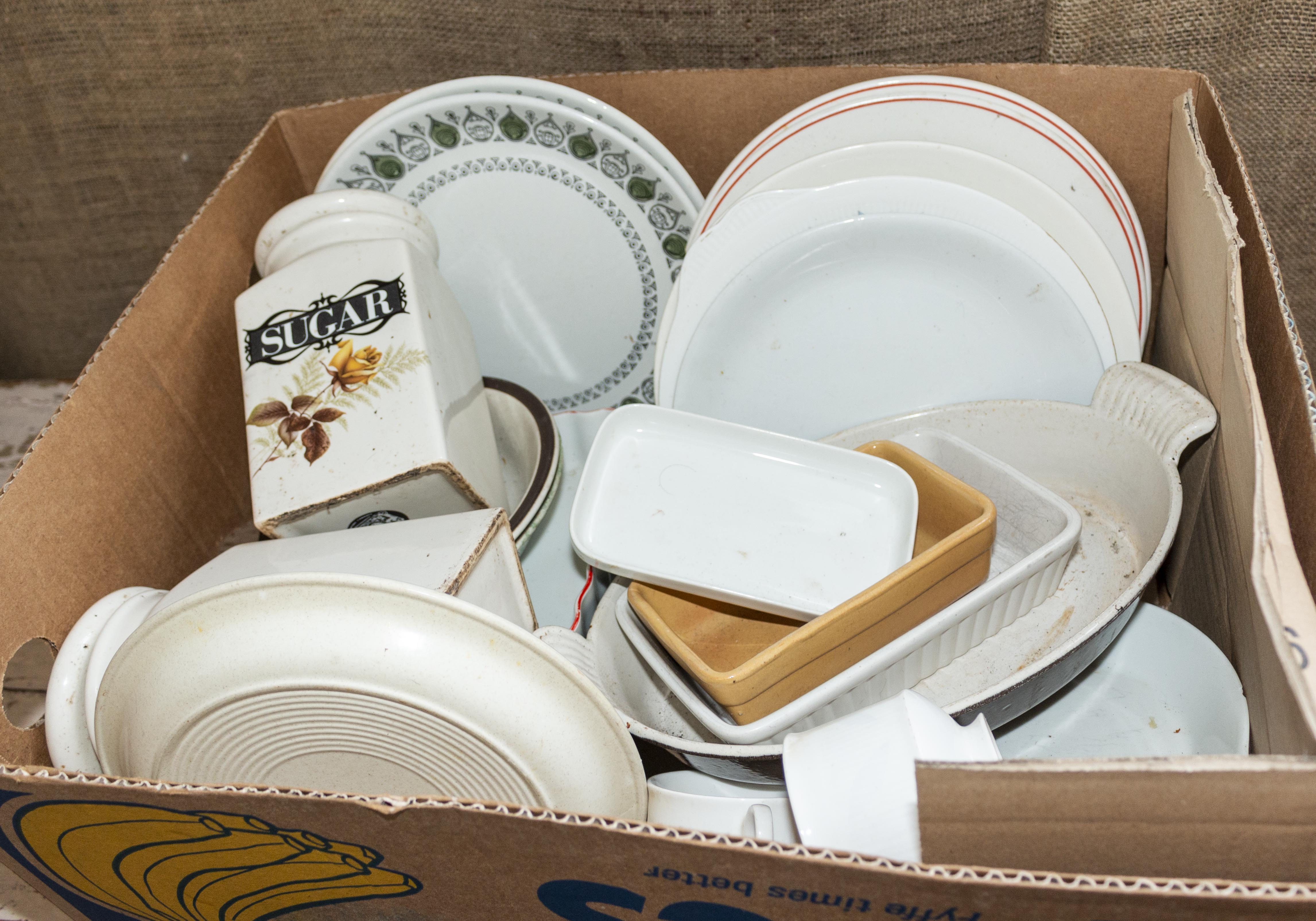 Lot 54 - A box of kitchen dishes and plates