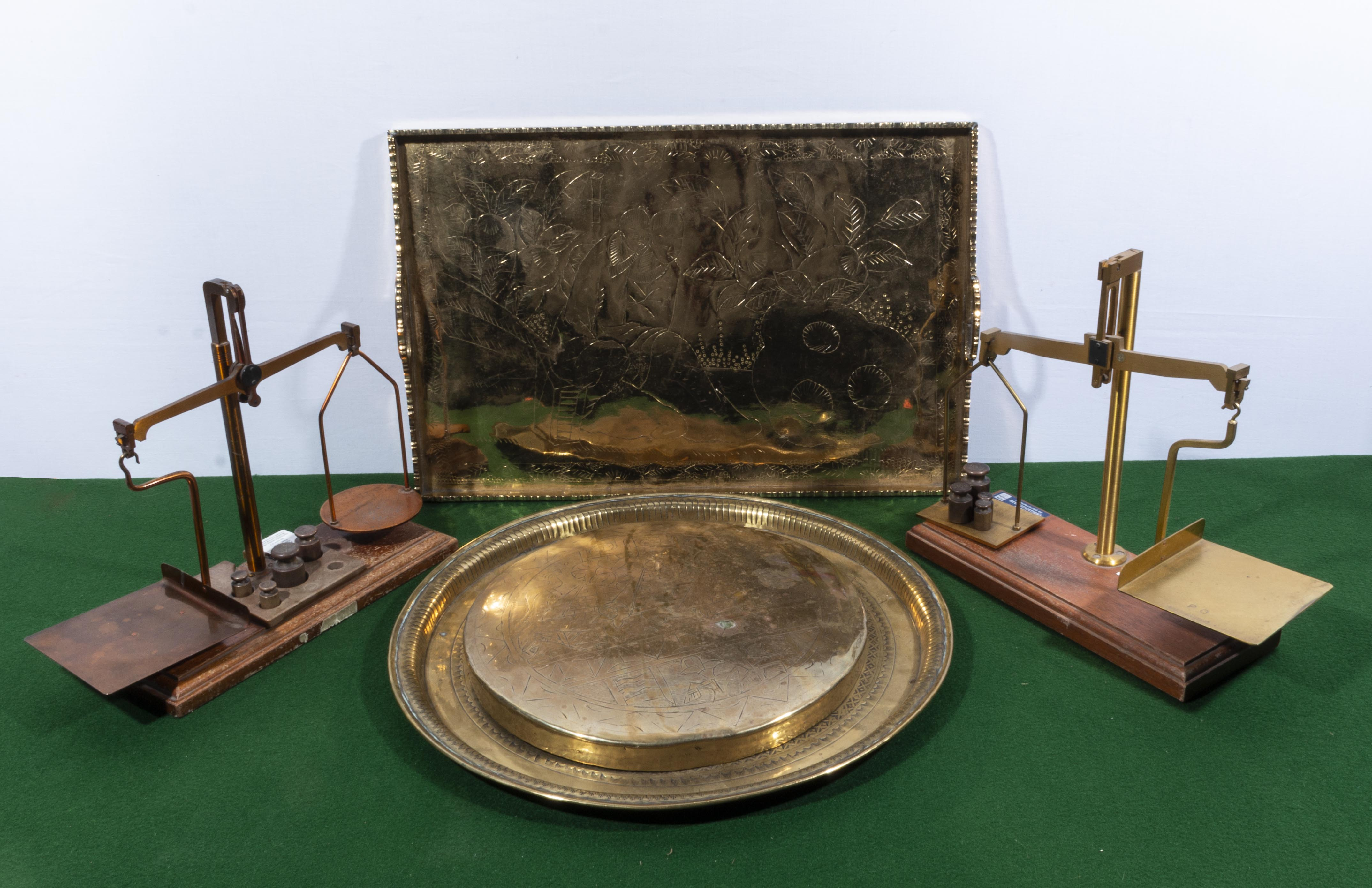 Lot 20 - Two post office scales, two brass trays and a gong