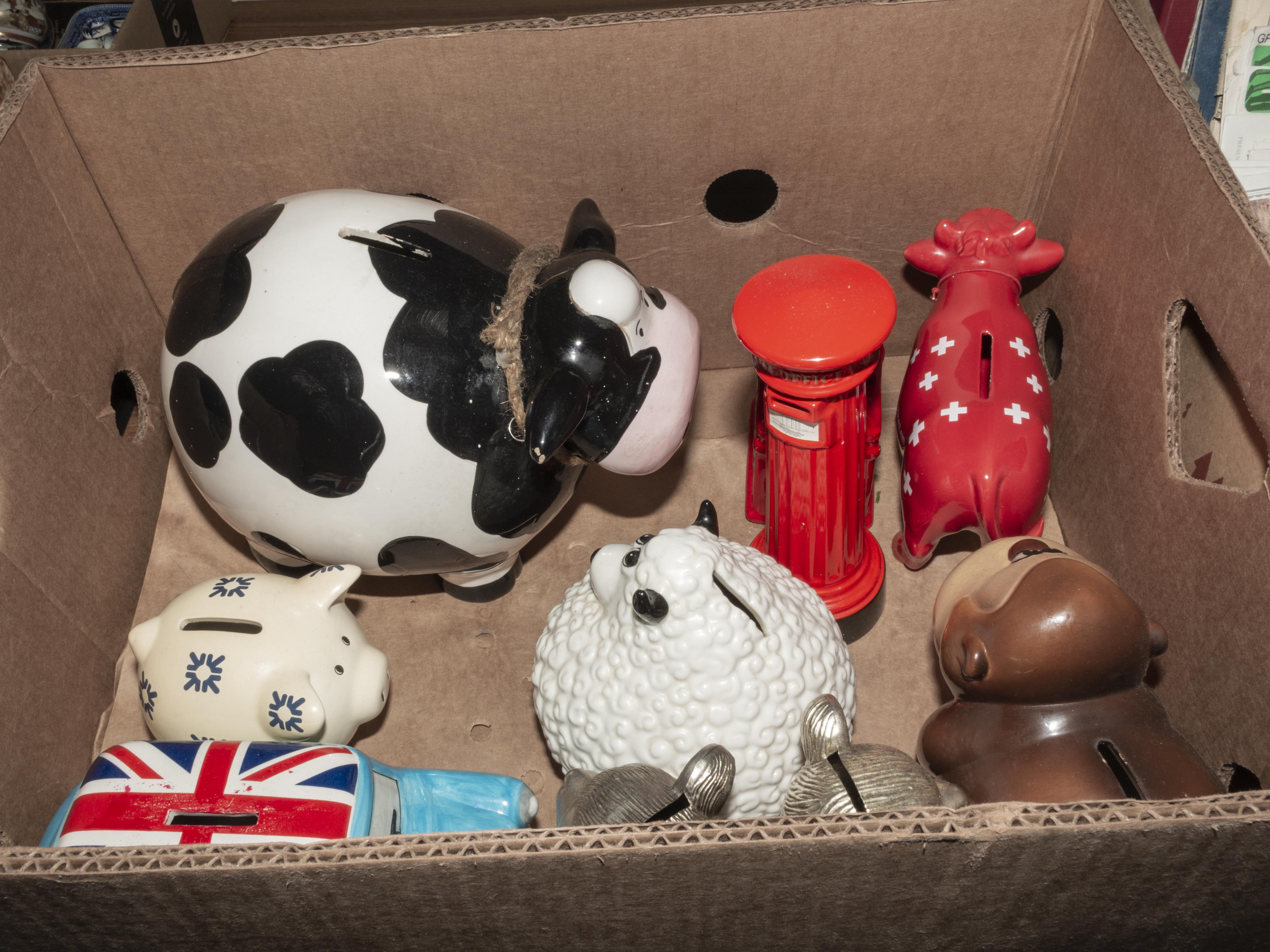 Lot 39 - A box containing pottery money banks