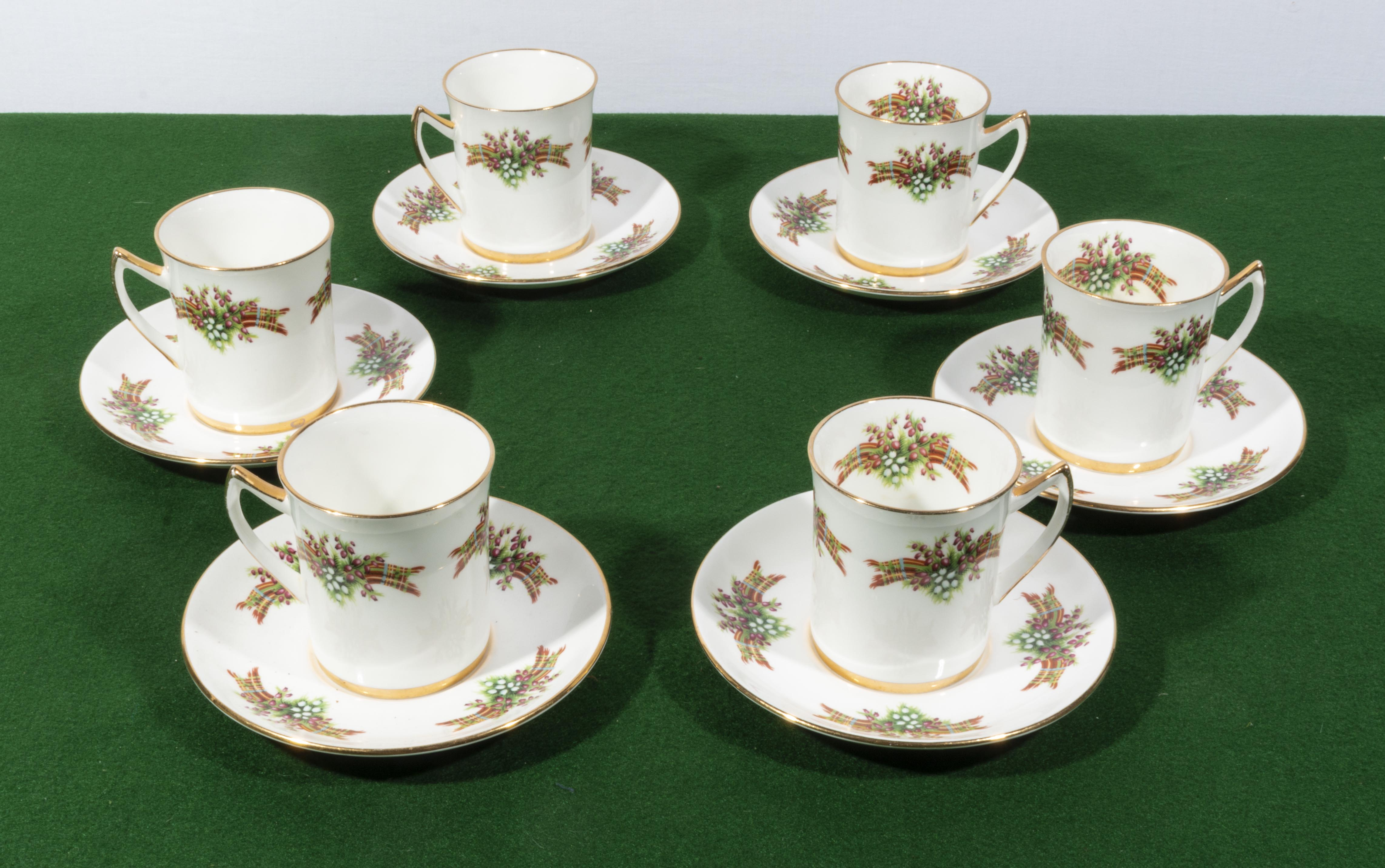 Lot 30 - Six coffee cups and saucers