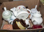 Lot 41 - A box containing pottery teapots