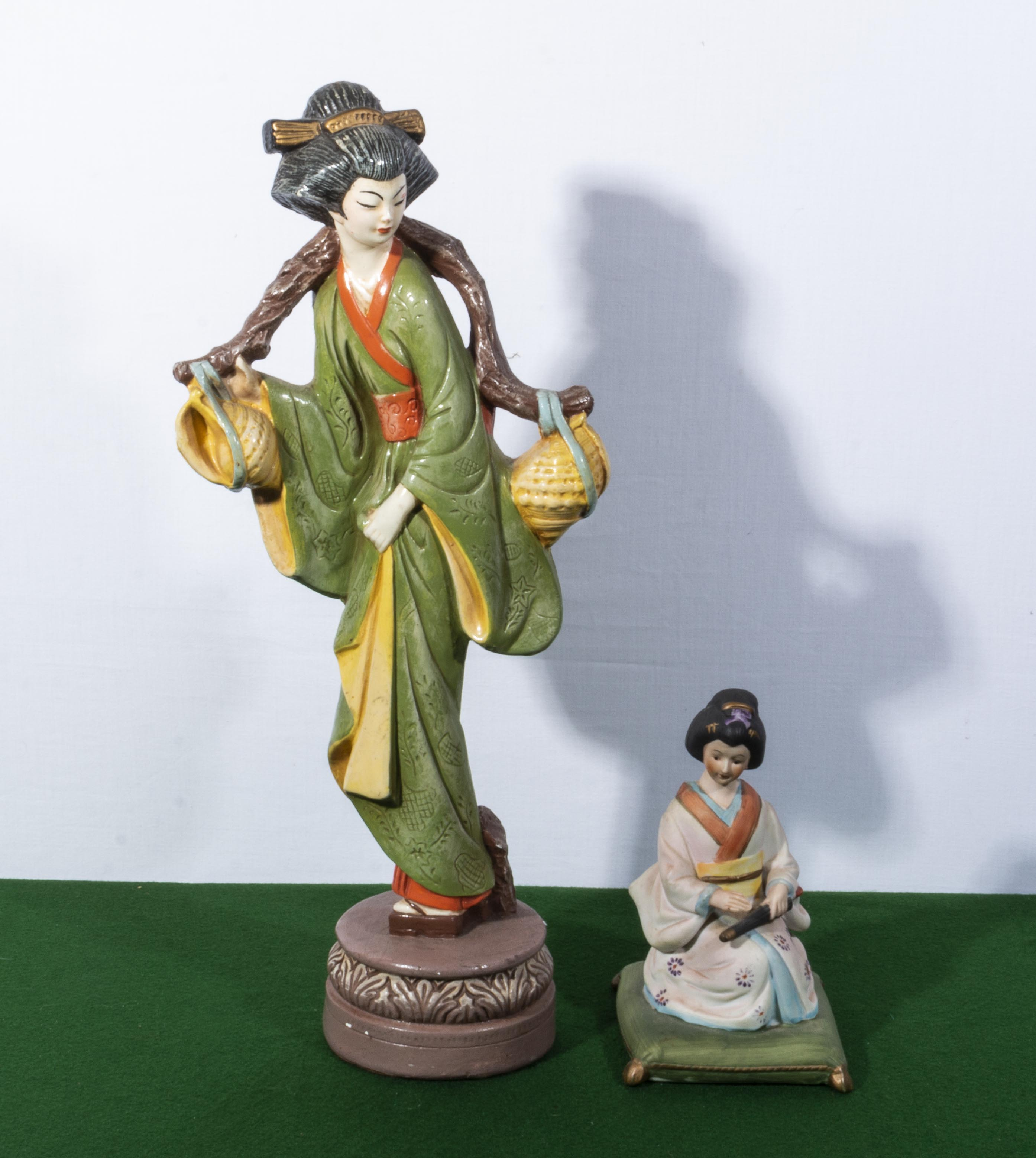 Lot 29 - Two Oriental style figures