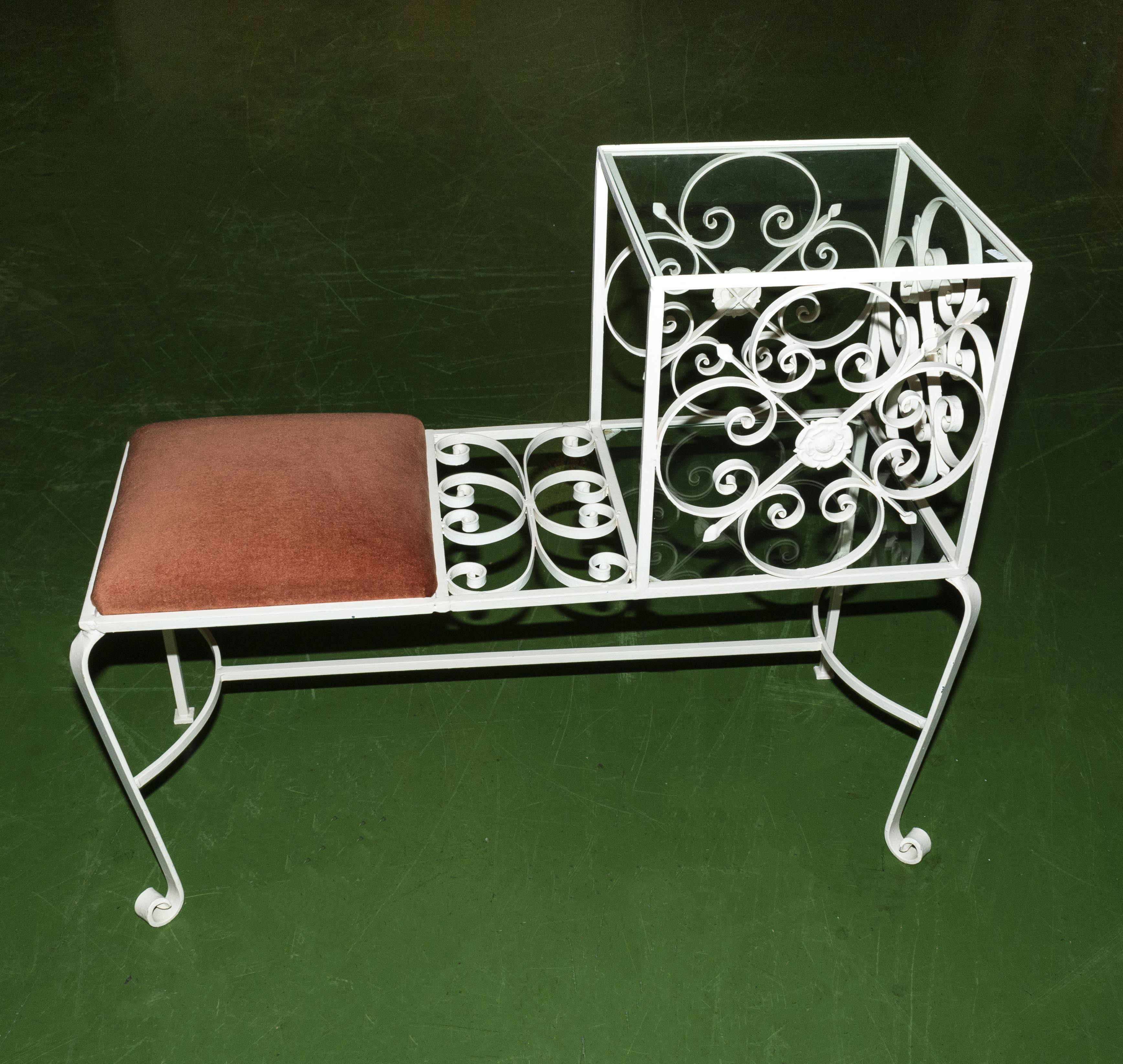 Lot 27 - A wrought iron hall/telephone seat