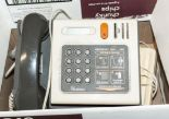 Lot 35 - A vintage payphone and two telephones