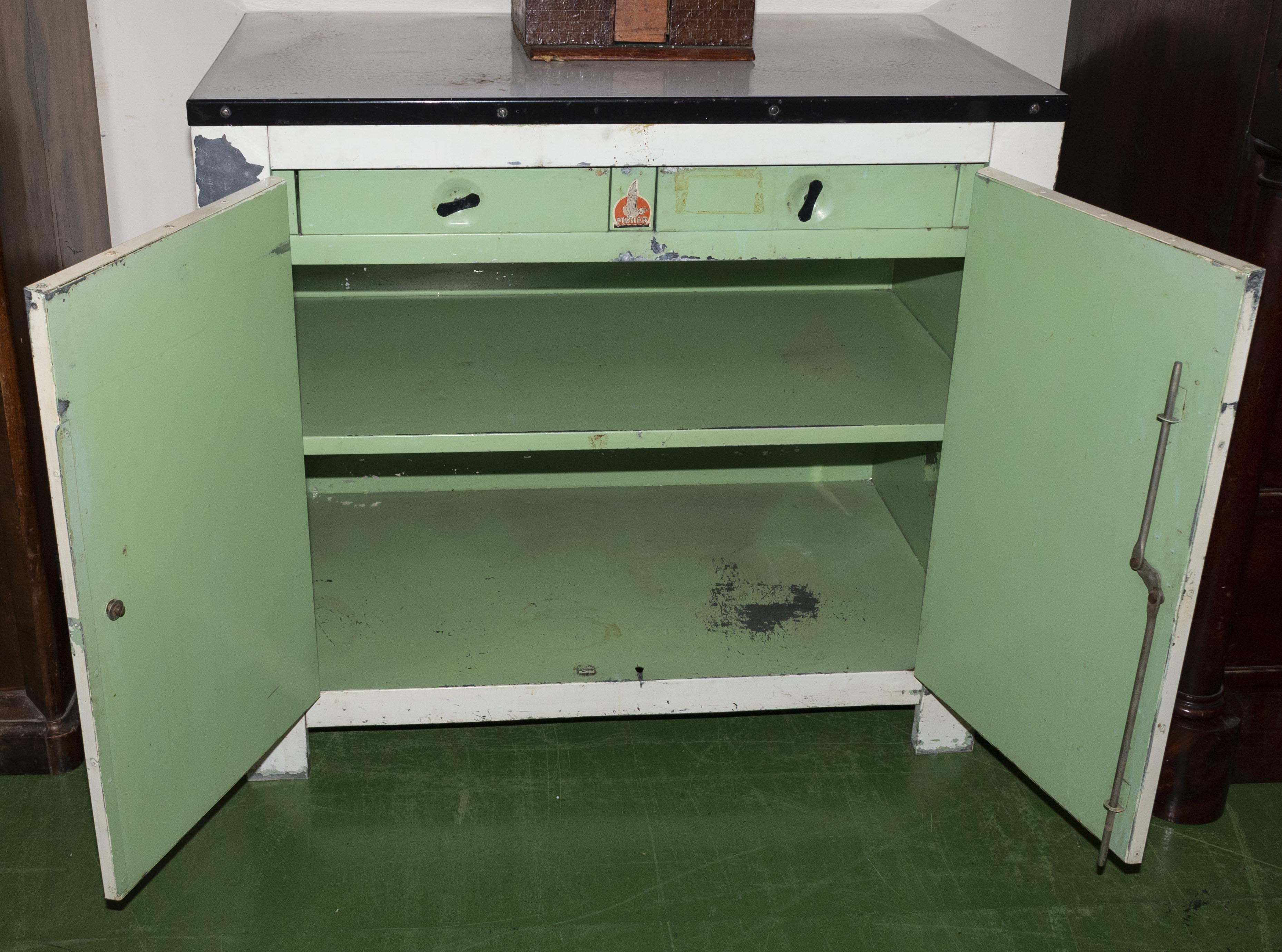 Lot 2 - A metal kitchen storage cabinet made by Fisher, bakelite handles and fitted interior .