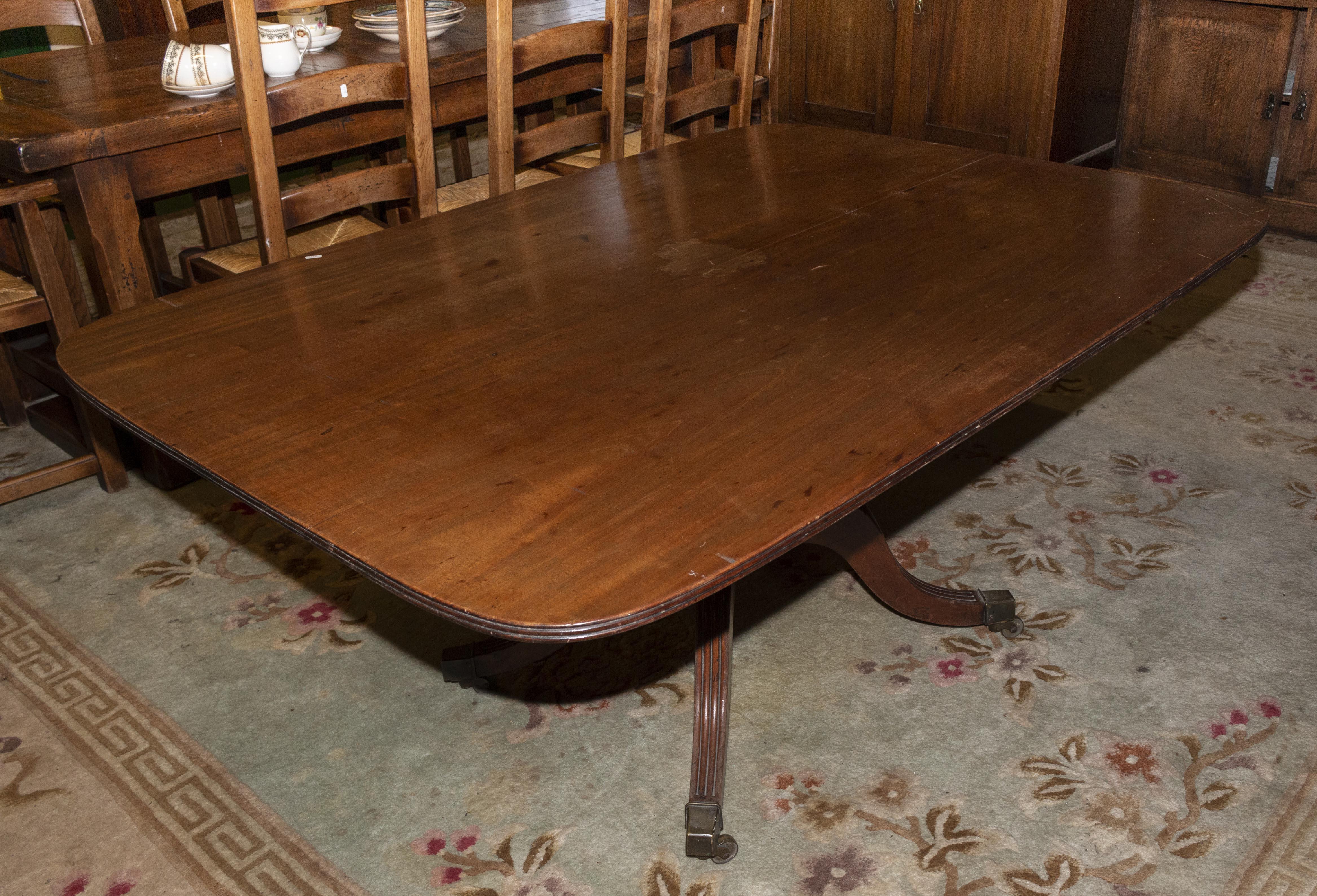 Lot 40 - A Georgian mahogany table on splayed leg centre column.