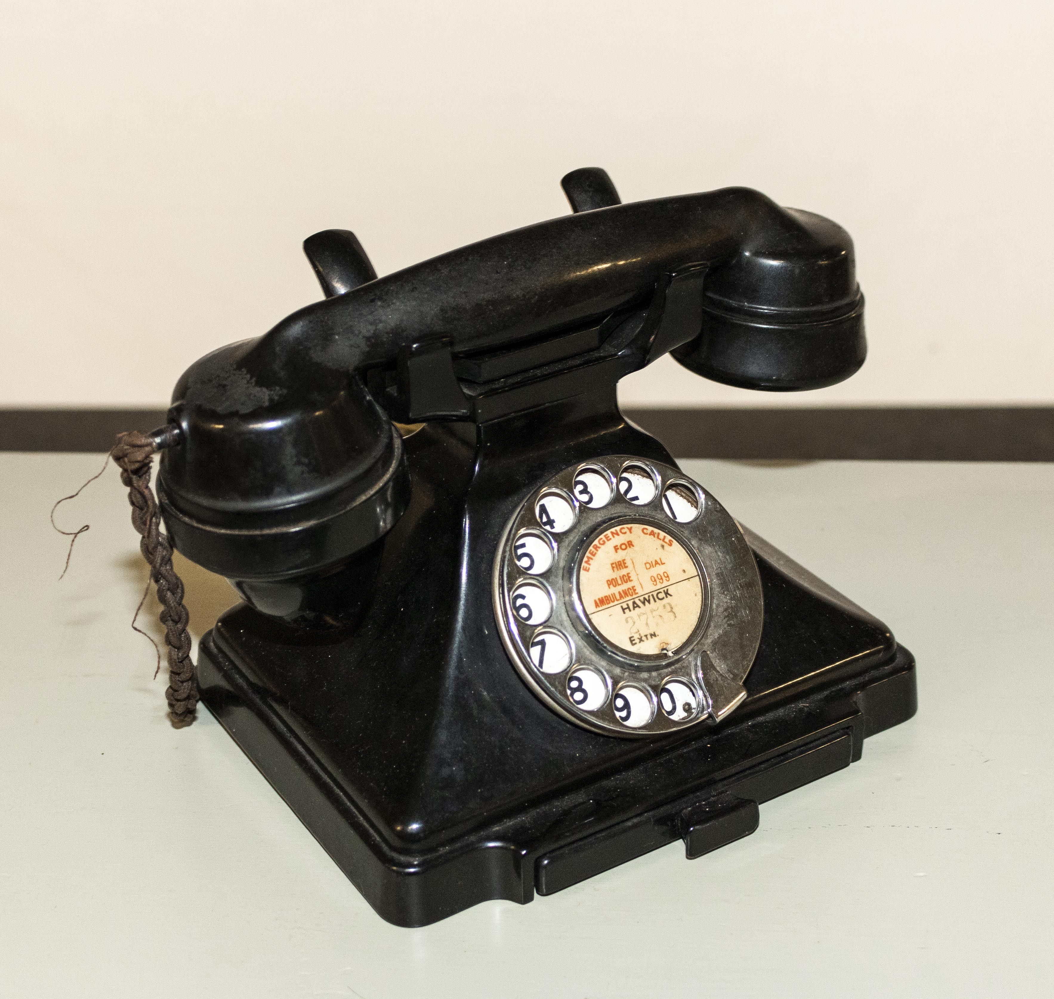 Lot 34 - A vintage bakelite telephone.