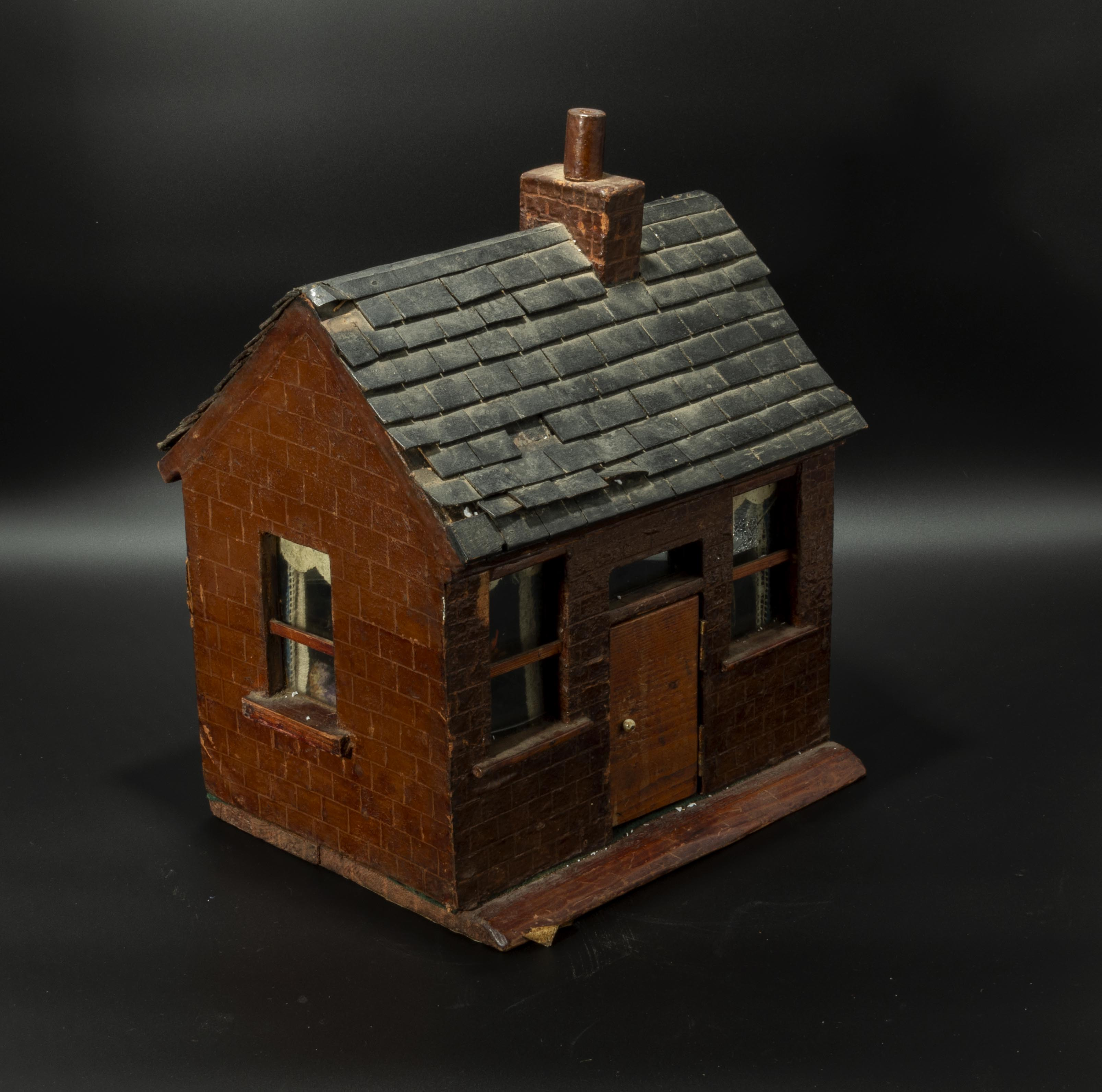 Lot 32 - A small naive doll's house made in 1933