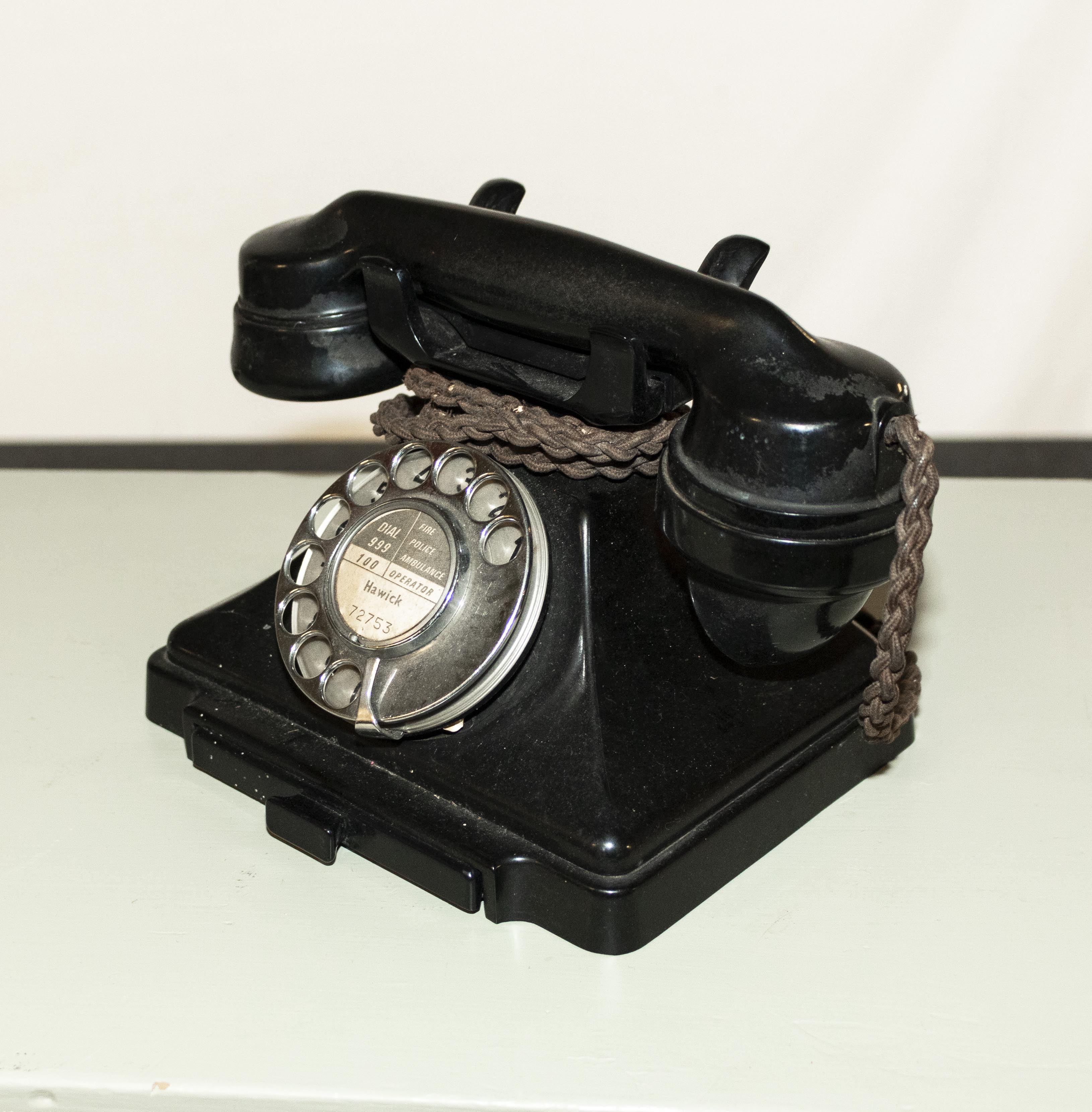 Lot 33 - A vintage bakelite telephone.