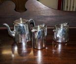 Lot 13 - A silver plated tea set.