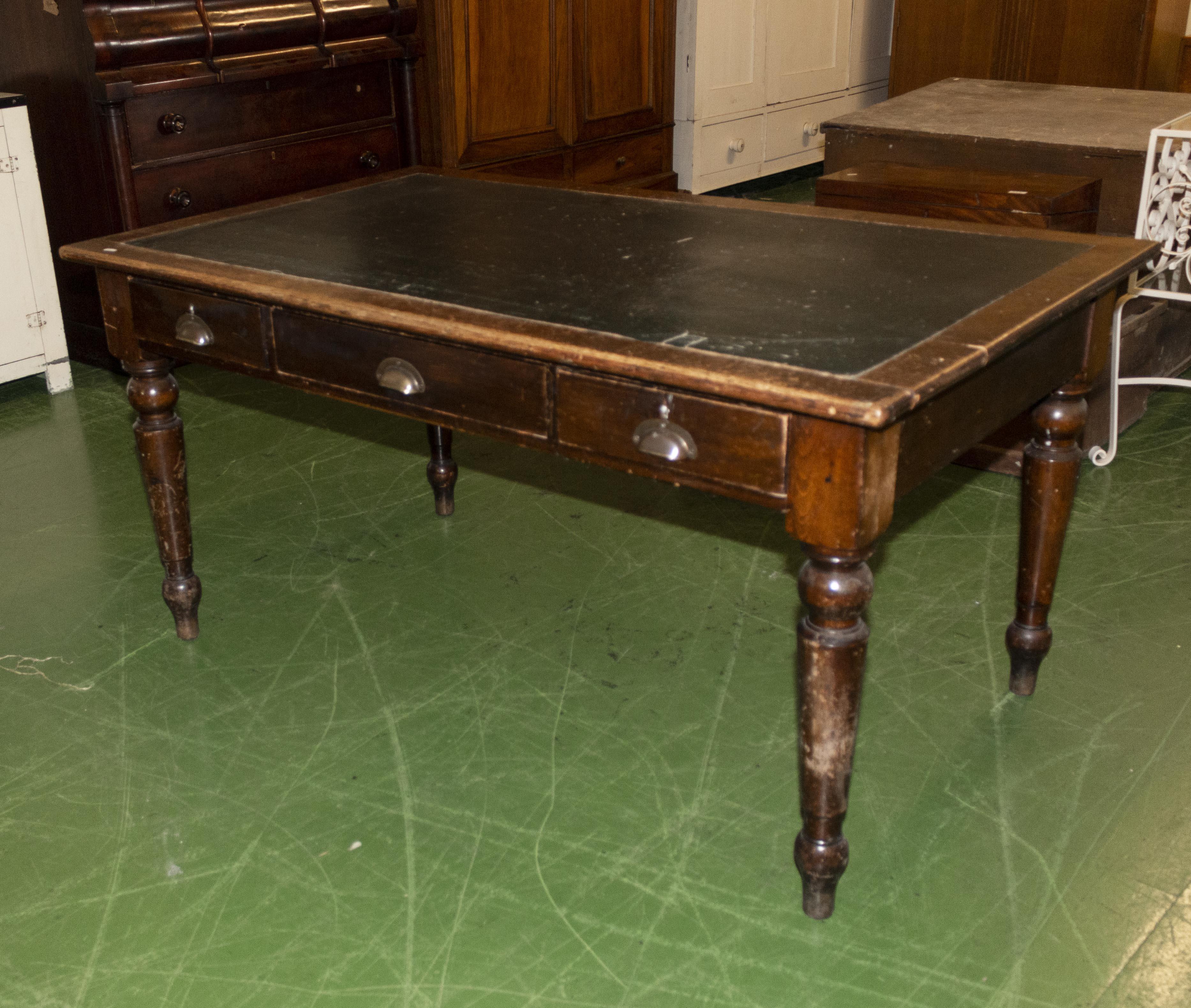 Lot 31 - An oak desk/table.