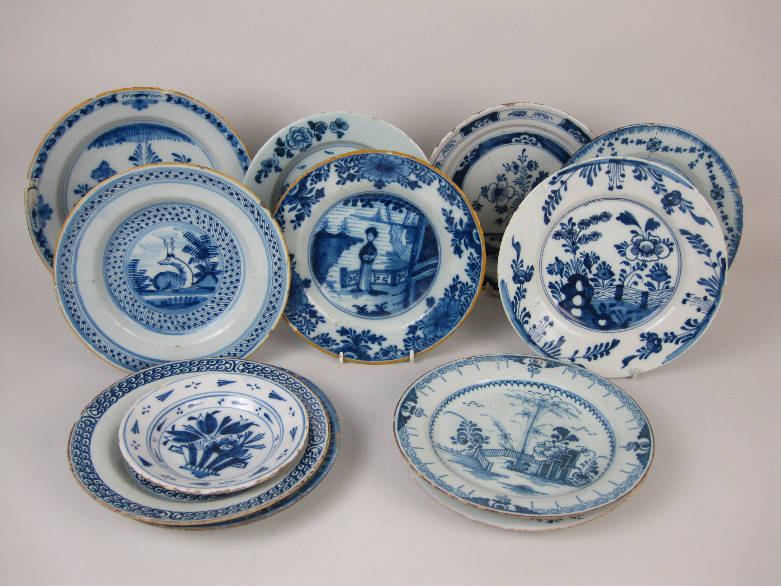 A Collection Of Twelve Delft Small Blue And White Plates Painted
