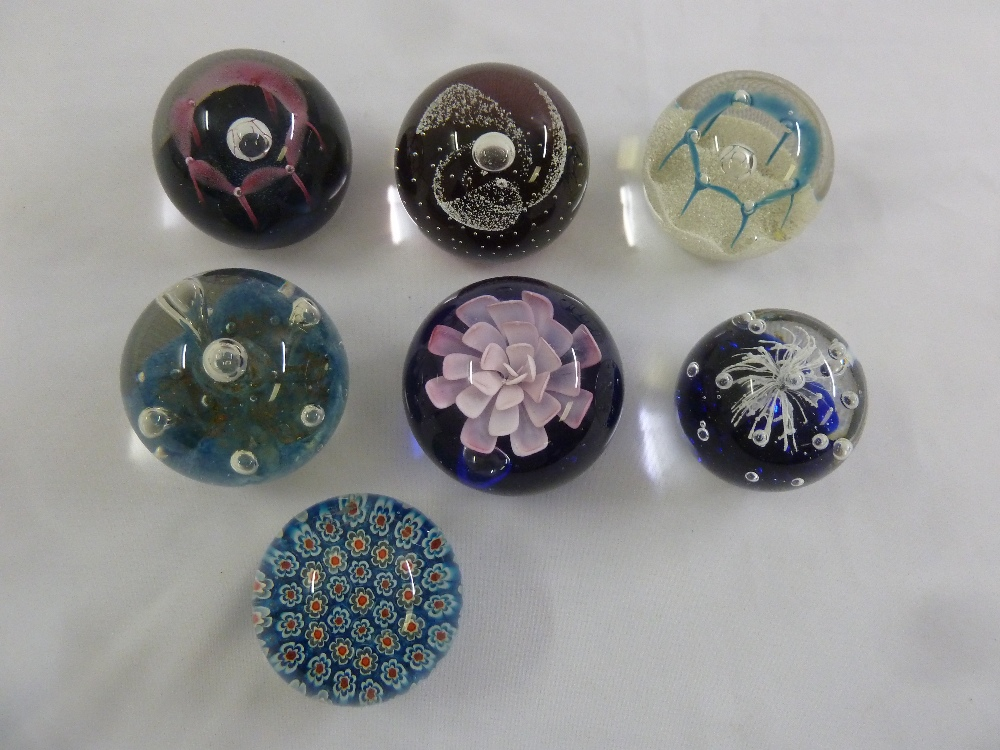 Lot 153 - Seven paperweights of various design to include Caithness