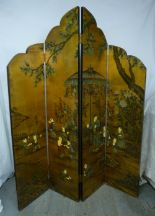 Lot 33 - A Chinese four section shaped screen decorated with figures in a garden