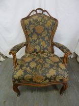 Lot 23 - A Victorian upholstered mahogany armchair on cabriole legs