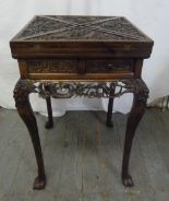Lot 11 - Chinese hardwood envelope card table, heavily carved with dragons and peonies (to include original
