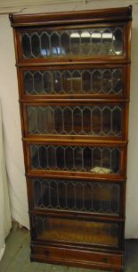 Lot 1 - An early 20th century six section Globe Wernicke with lead lined glass panels and bottom drawer