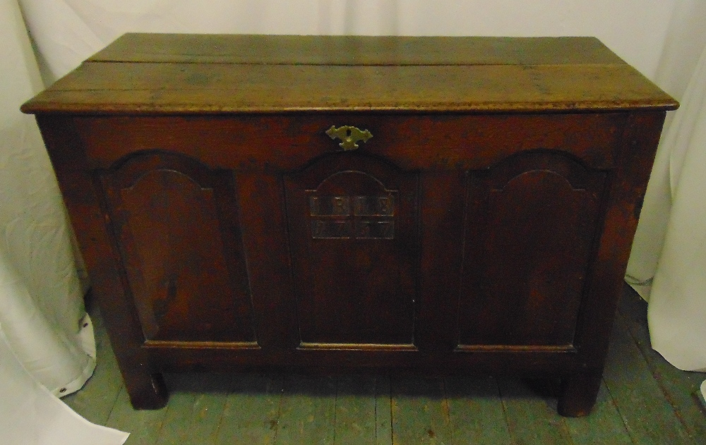 Lot 18 - An early 18th century oak coffer carved with the date 1737 on four rectangular supports