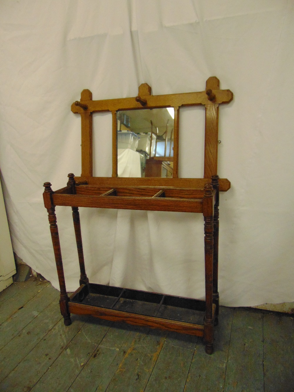 Lot 49 - A rectangular oak wall mounted hat and coat rack and an umbrella stand