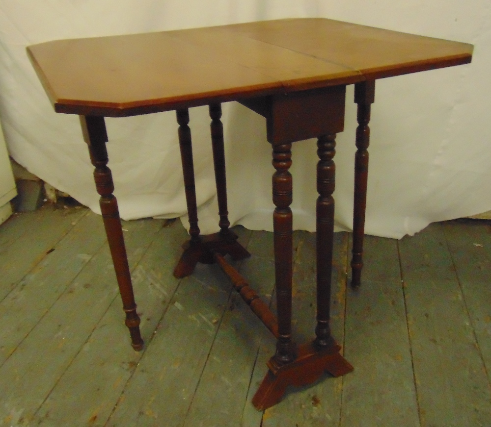 Lot 29 - A 19th century rectangular mahogany Sutherland table with turned cylindrical supports