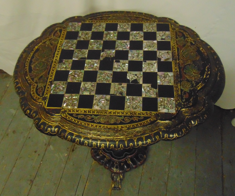 Lot 33 - A Victorian ebonised papier mache oval tilt-top games table by Jenners & Bettridge inlaid with