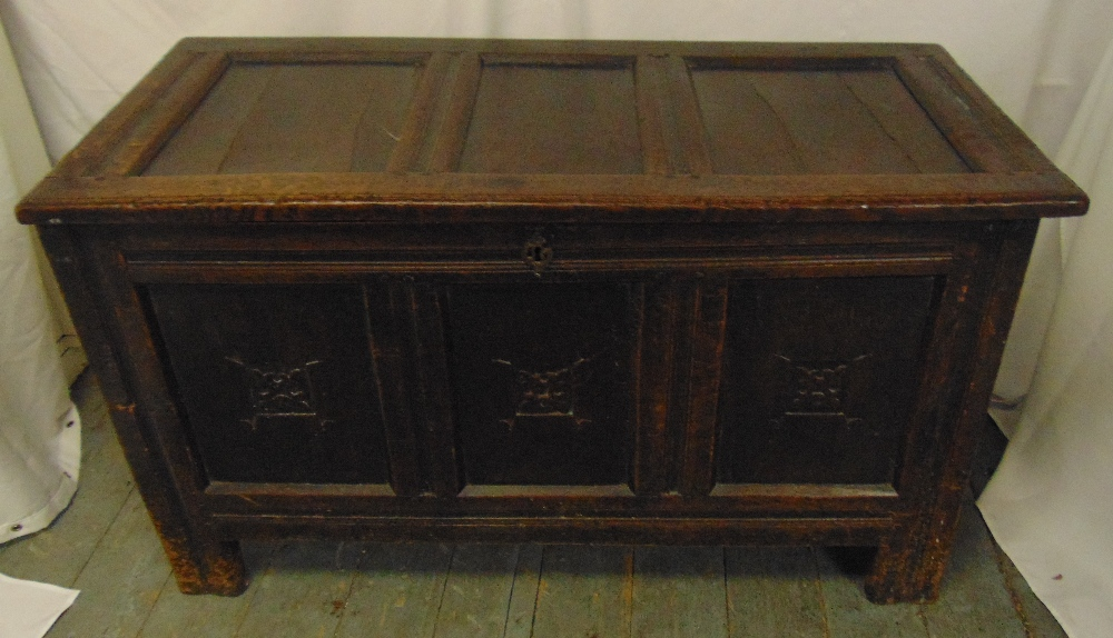 Lot 19 - An 18th century rectangular oak coffer, the scroll carved front panels with hinged cover on four