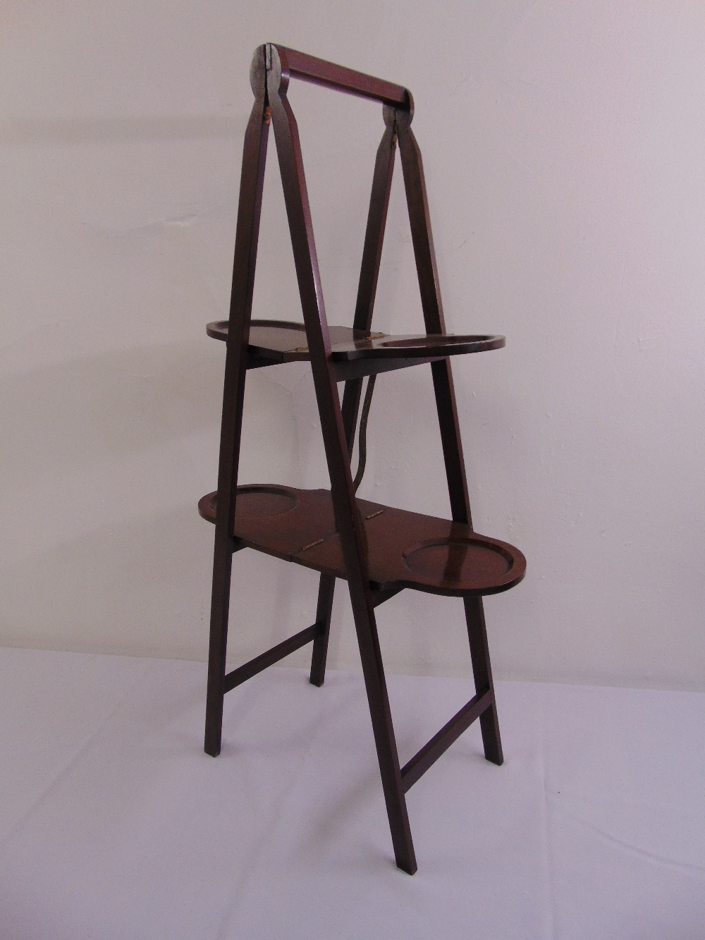Lot 47 - A mahogany A frame double sided plate stand