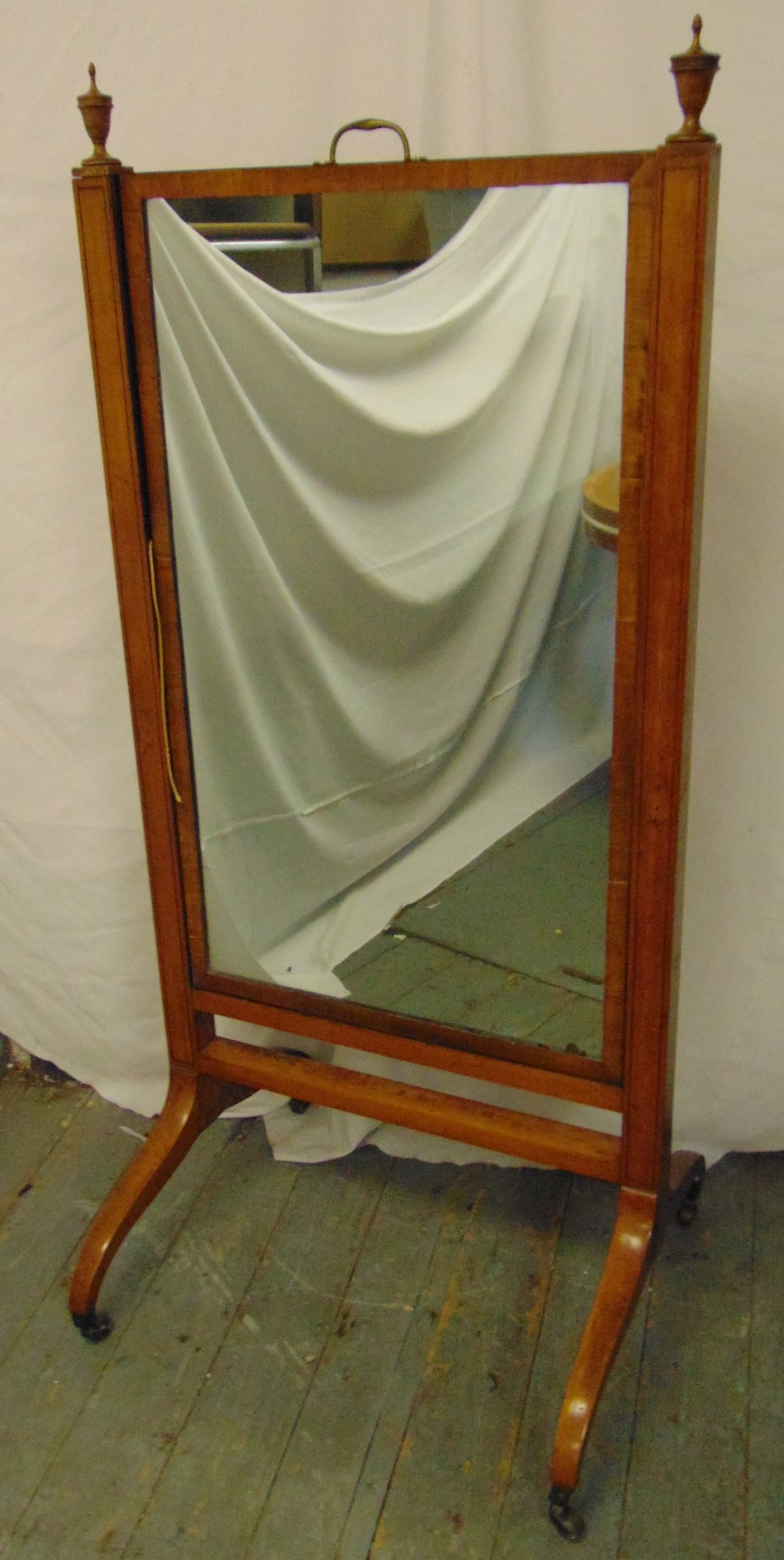 Lot 52 - A rectangular Cheval mirror, the supports surmounted with urn finials, on scroll legs with brass