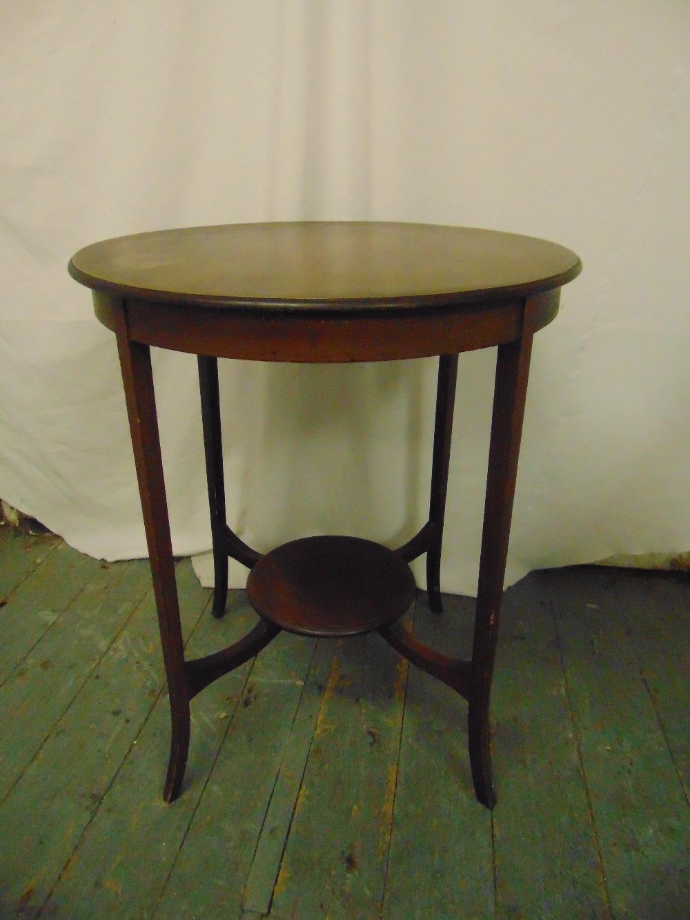Lot 30 - An Edwardian mahogany circular occasional table on tapering rectangular legs