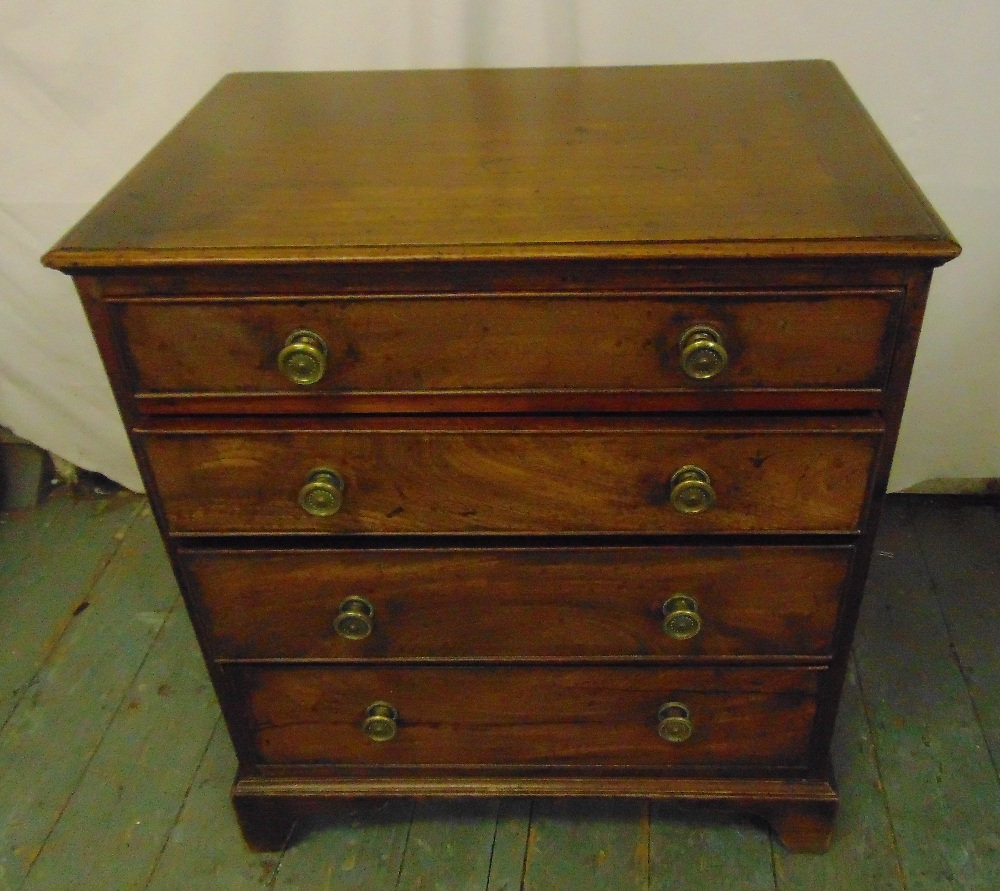 Lot 15 - A 19th century rectangular mahogany chest of drawers with brass swing handles on four bracket feet