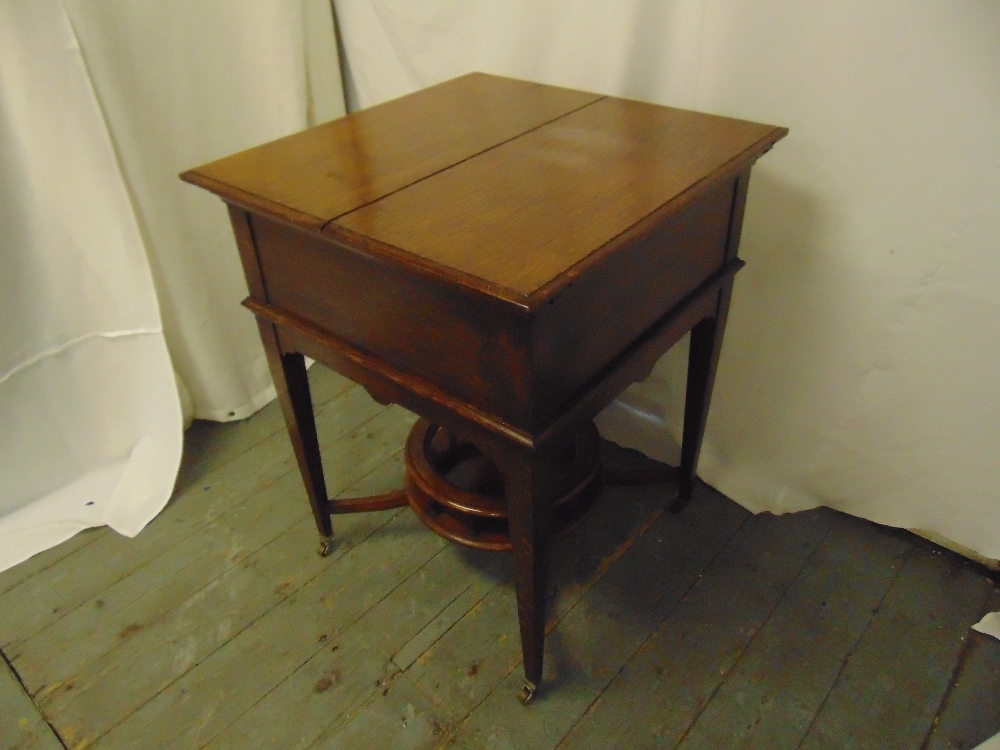 Lot 27 - A mahogany rectangular occasional table cum drinks stand, on four tapering rectangular legs