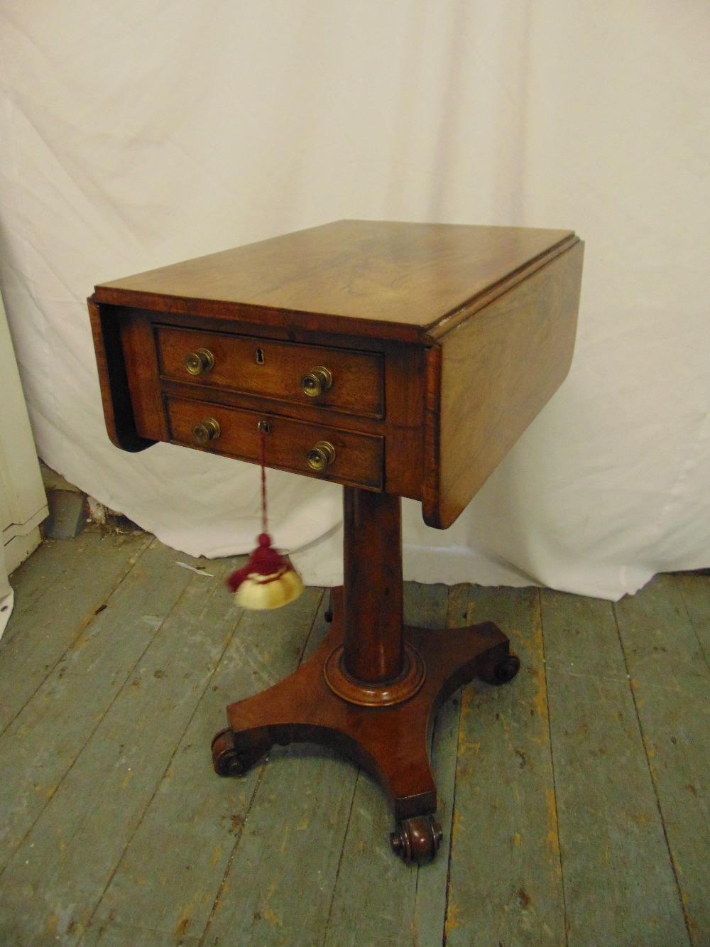 Lot 26 - A 19th century rectangular flame mahogany two drawer drop flap side table on columnar stem, shaped