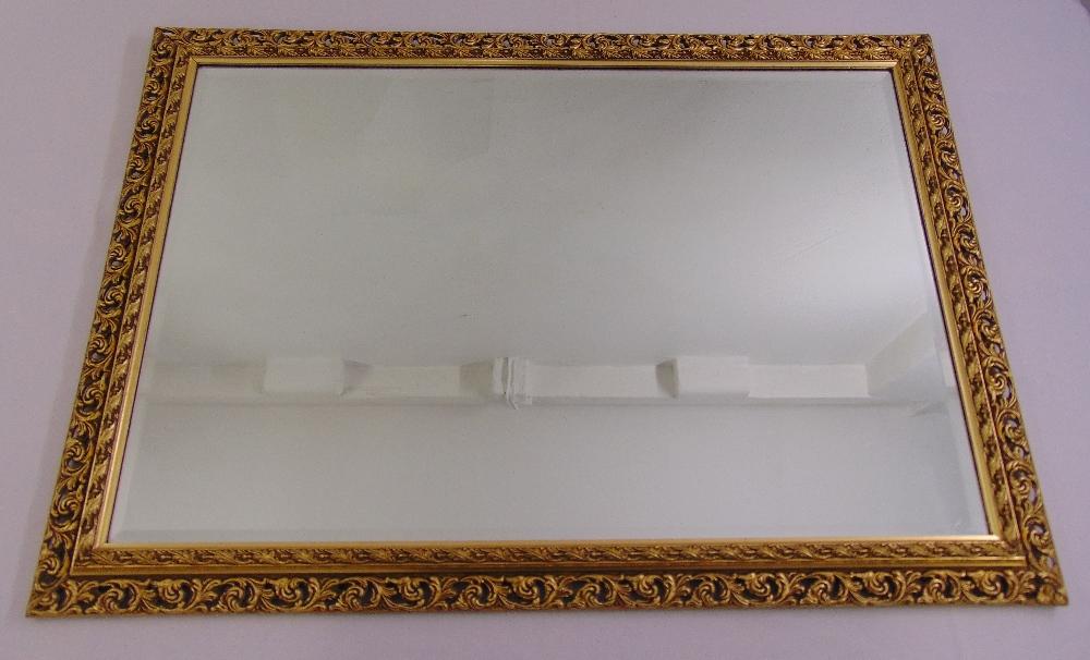 Lot 55 - A gilt framed bevel edge rectangular wall mirror, 73 x 104cm