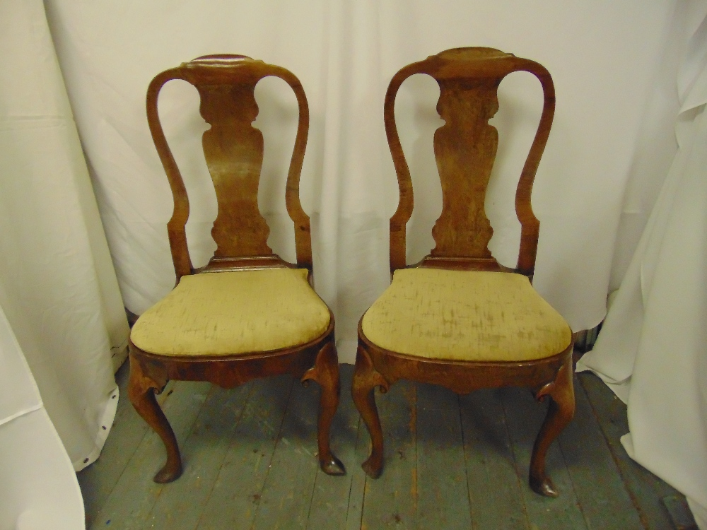 Lot 41 - A pair of Georgian walnut open splat back bedroom chairs with padded upholstered seats on four