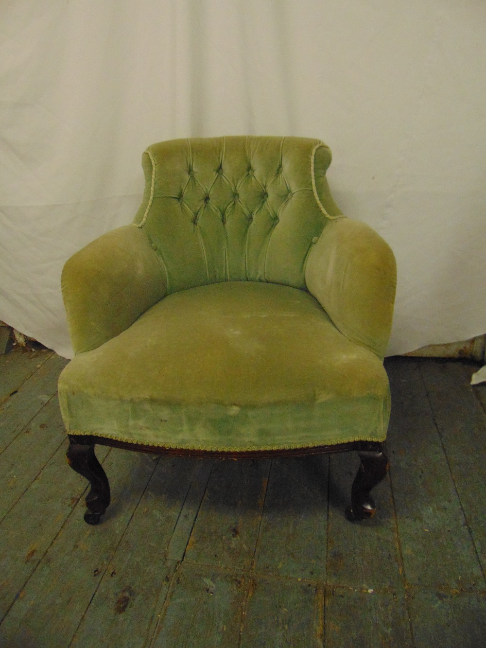 Lot 40 - An early 20th century mahogany upholstered tub chair on scroll legs