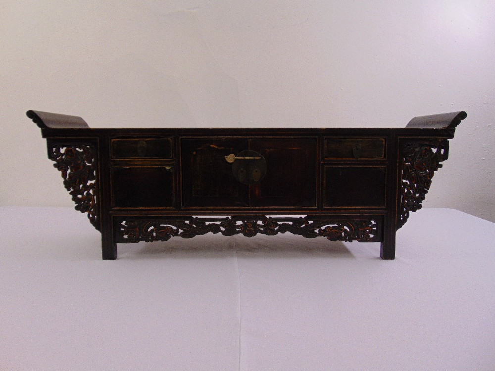Lot 24 - An Oriental rectangular ceremonial hardwood alter carved with dragons and comical figures