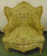 Lot 36 - A French style upholstered armchair on four scroll legs