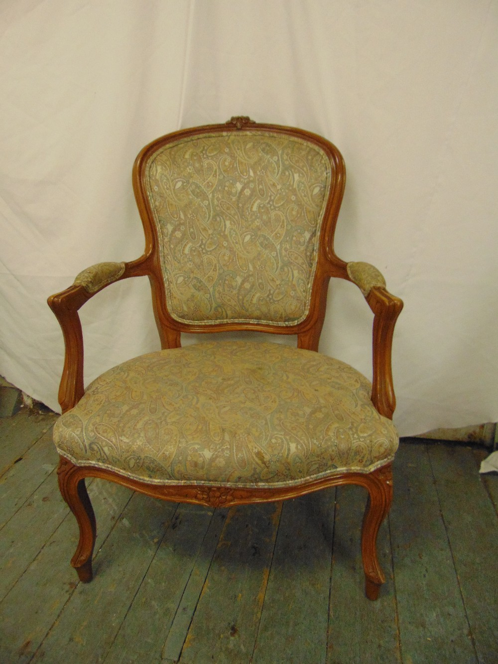 Lot 38 - A French style mahogany upholstered armchair on four cabriole legs