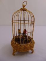 Lot 284 - An automaton of singing birds in a gilt metal cage