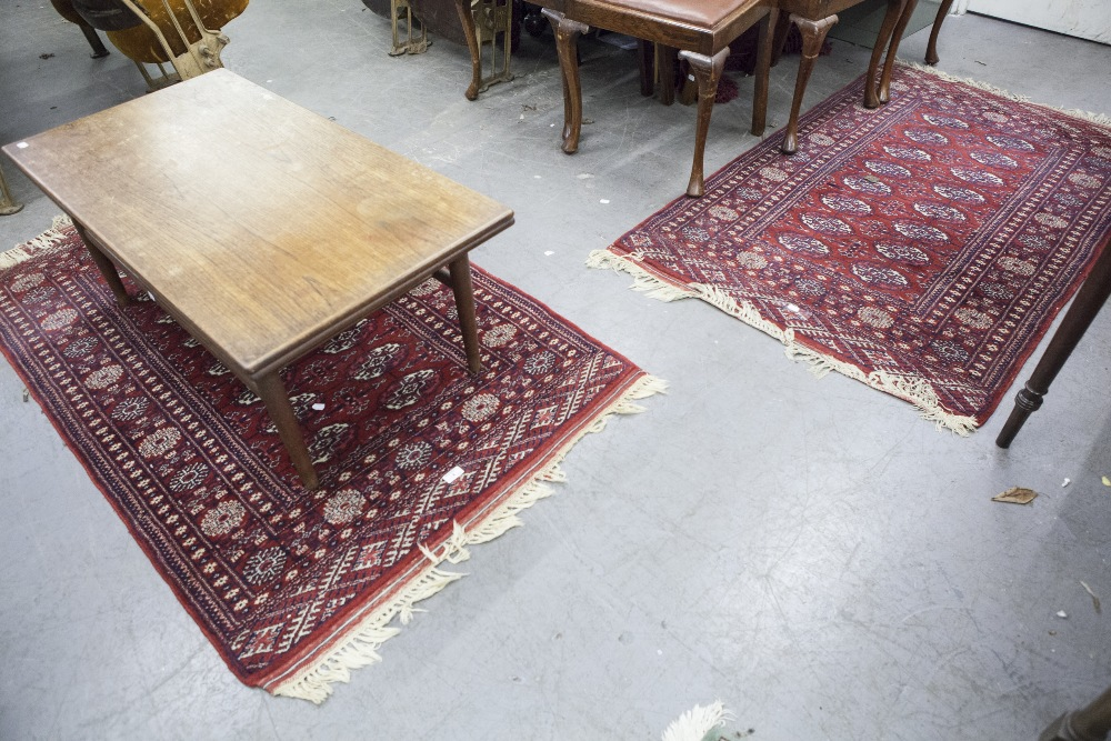 Lot 4 - TWO MODERN MIDDLE EASTERN STYLE RUGS ON WINE RED GROUND