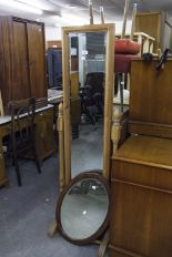 Lot 46 - A MODERN PINE CHEVAL DRESSING MIRROR AND A WOODEN FRAMED OVAL WALL MIRROR