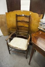 Lot 15 - A WALNUTWOOD PANEL SINGLE BEDSTEAD AND A LADDER BACK NURSING CHAIR