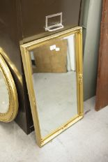 "Lot 8 - AN OBLONG BEVELLED WALL MIRROR, IN FLORAL EMBOSSED GILT FRAME, 28"" X 17"" OVERALL"