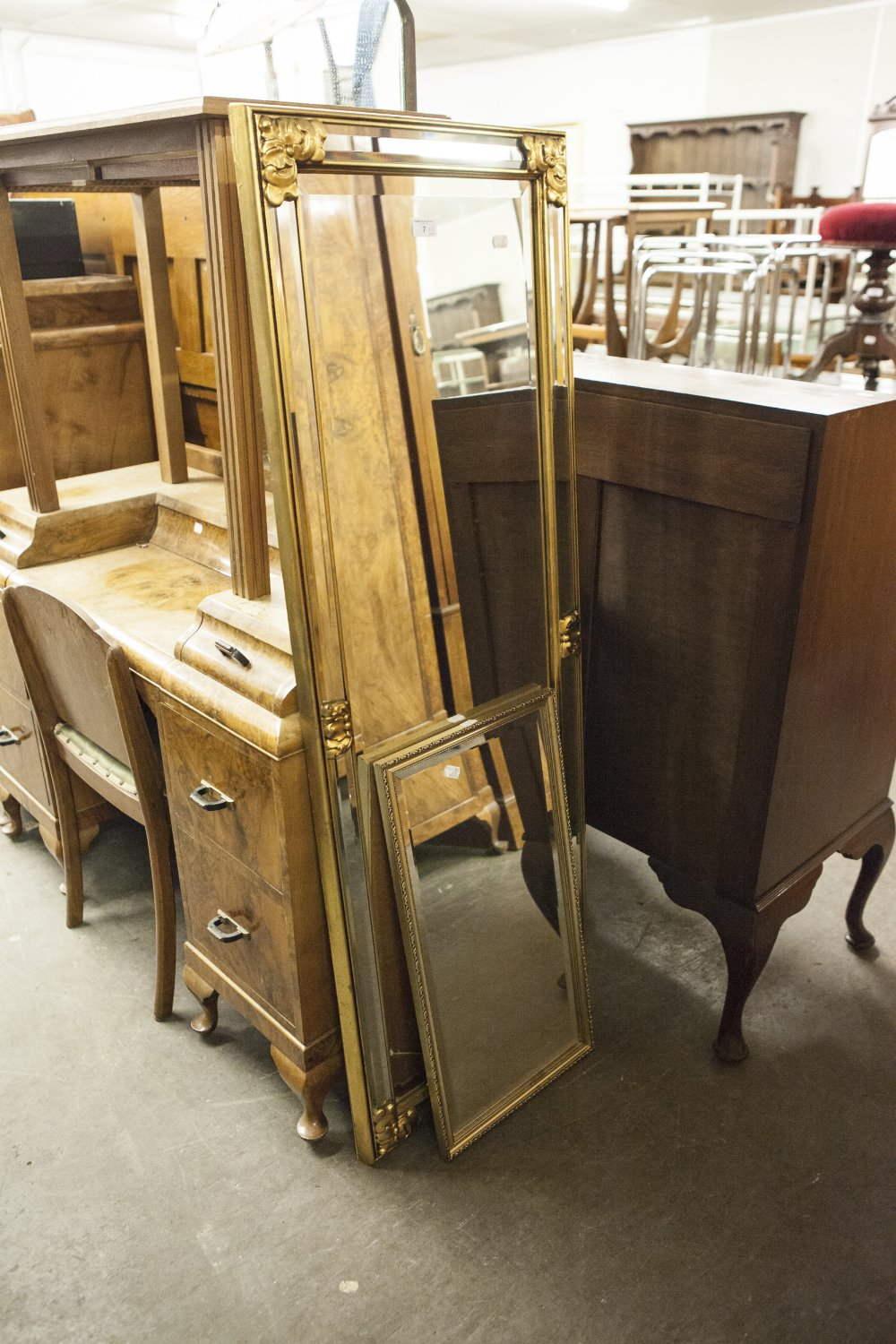 "Lot 7 - A GILT FRAMED ROBING MIRROR AND A GILT FRAMED OBLONG WALL MIRROR, 25"" X 13"" OVERALL"